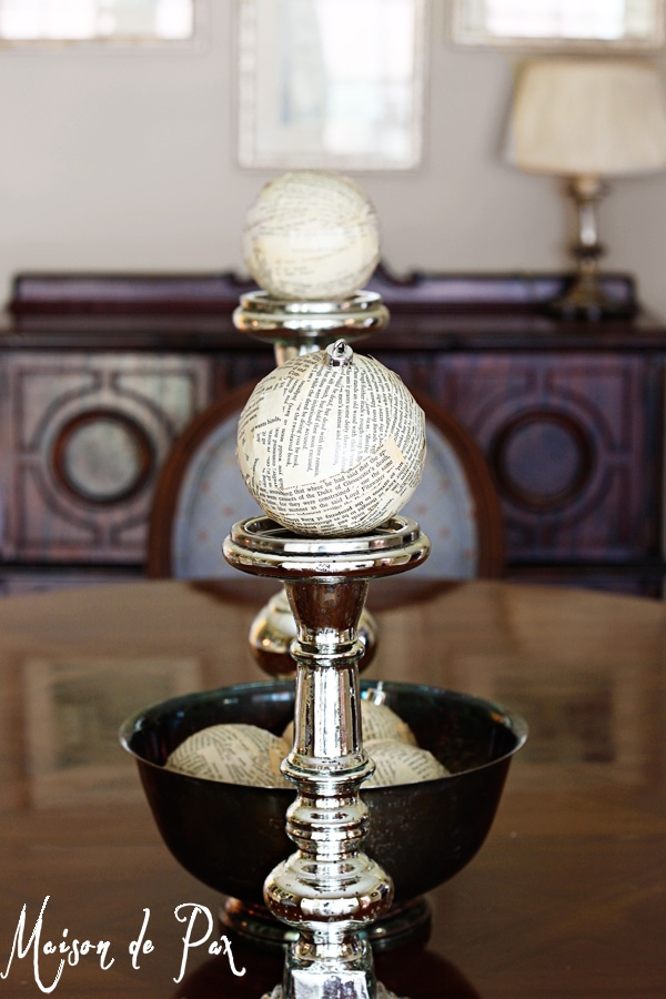 book page ornaments atop candlesticks