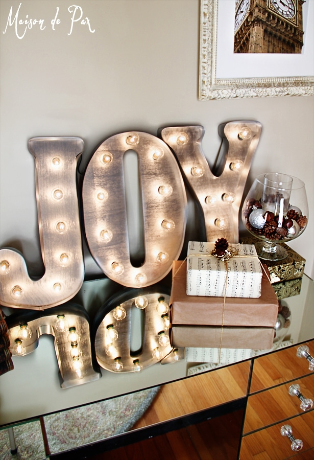 simple and stunning gift wrap ideas: juxtapose rustic and sparkly elements