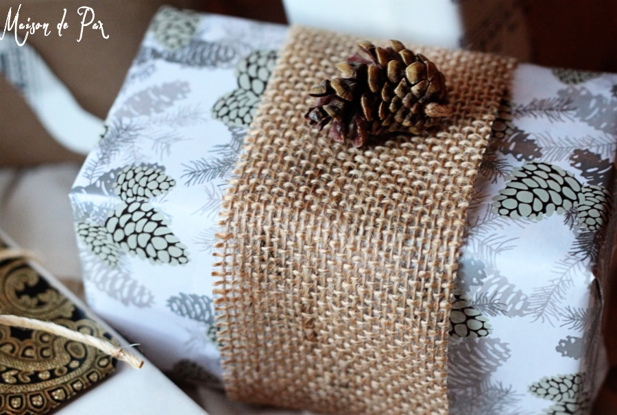 simple and stunning gift wrap ideas: hot glue pinecones as embellishments