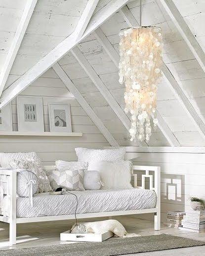 brightly whitewashed attic room