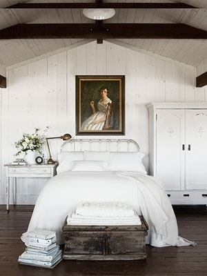 whitewashed, all white attic bedroom