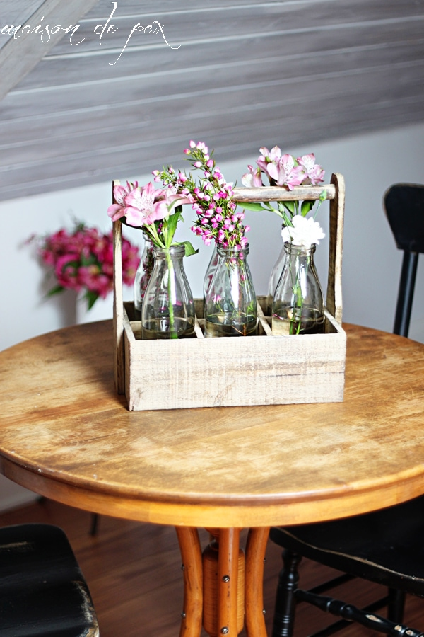 This stunning carrier made from reclaimed wood holds 6 antique milk bottles and makes the perfect rustic yet elegant piece of decor!