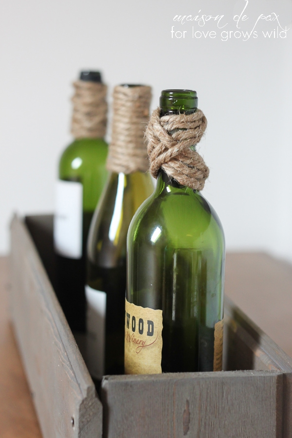 These Twine-Wrapped Bottles are inexpensive to make and the perfect easy DIY decor project! Use them as a centerpiece, vases, bookends, and more! | LoveGrowsWild.com