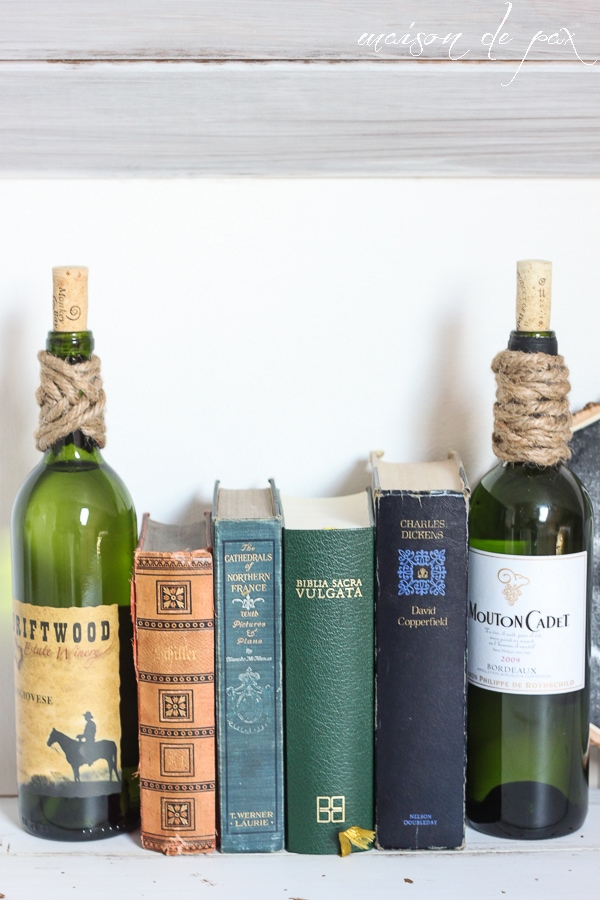 Use empty wine bottles (filled with water or sand) as bookends!  via maisondepax.com