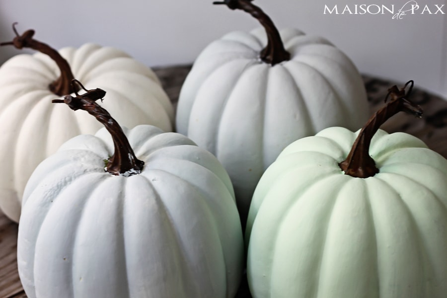 try this paint and wax technique to make plastic pumpkins look like real heirloom pumpkins via - Plastic Pumpkins