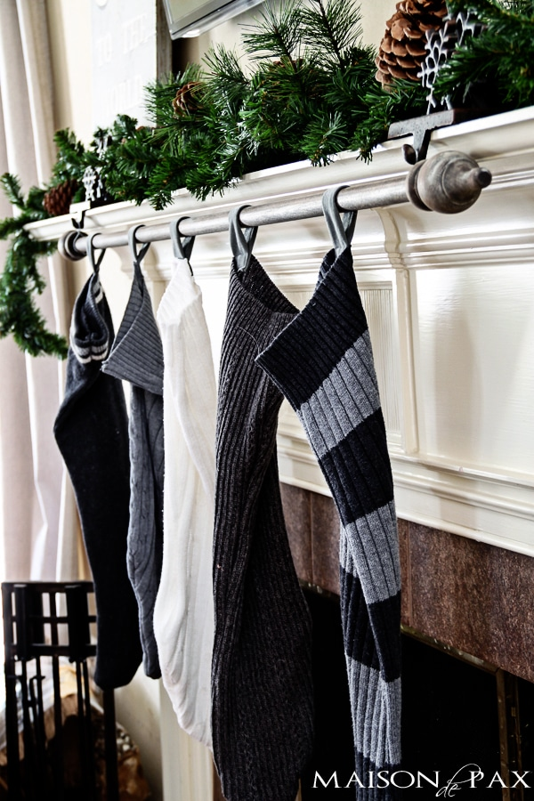 Classy (and cheap!) DIY stocking holder: use a curtain rod | via maisondepax.com #Christmas #diy #decor