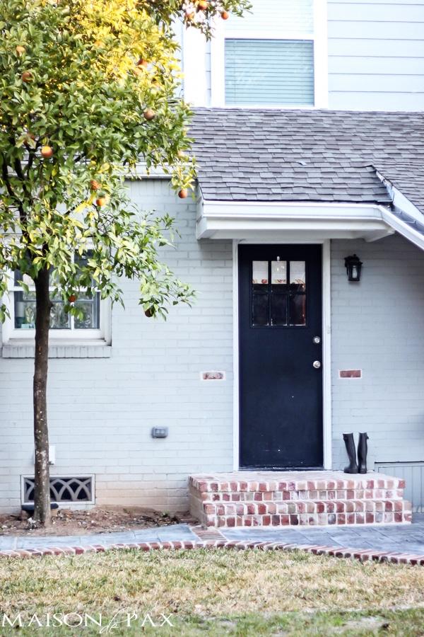 Stamped Concrete Patio (back door and orange tree)