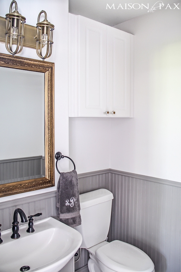 Gorgeous half bath with gray wainscoting, white walls, and gold metallic accents | maisondepax.com