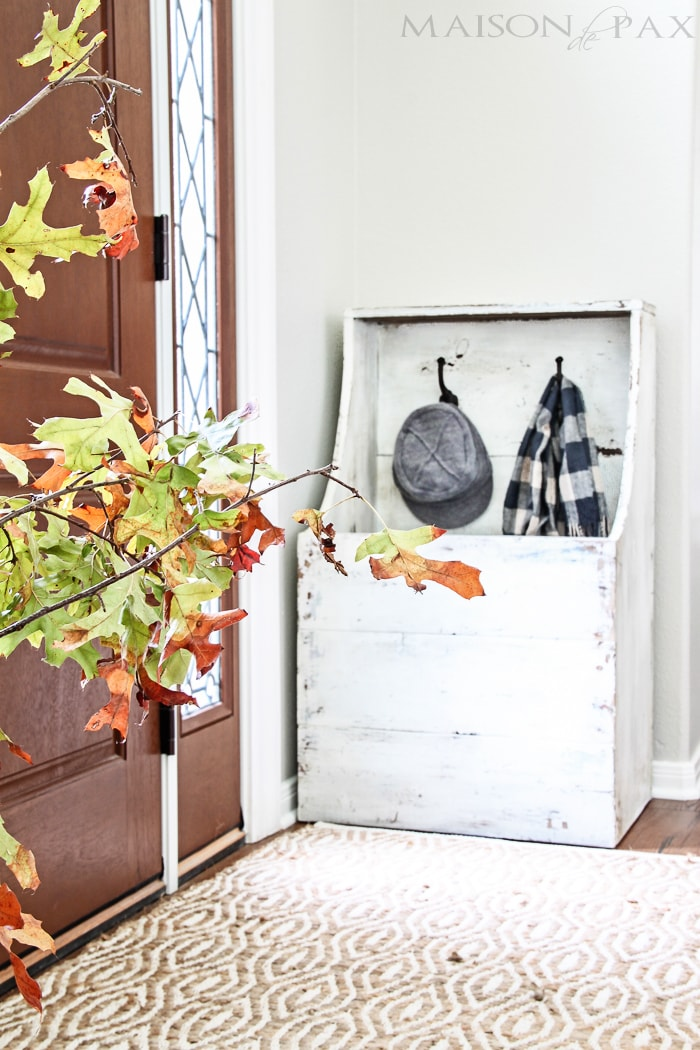"gorgeous, functional entryway with an antique wood firebox used as a mini mudroom... get the plans to build this diy planked ""antique"" firewood box here! 