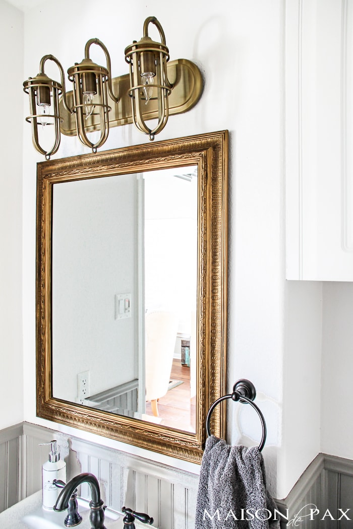 gorgeous rustic, chic bathroom: gold mirror, rustic wood towel rack... perfect balance of high and low | maisondepax.com