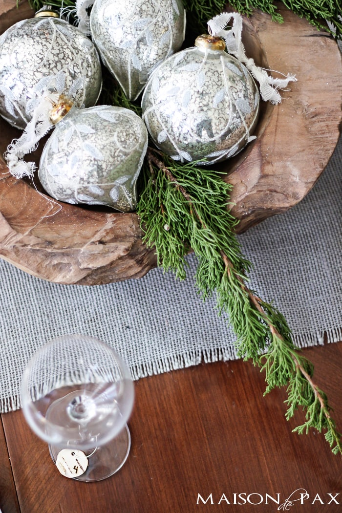 Winter table centerpiece with mercury glass ornaments and greenery in a wooden bowl | maisondepax.com