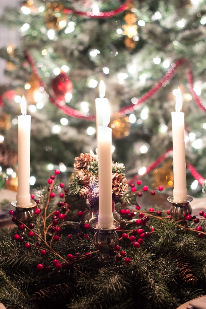 Gorgeous candle centerpiece in front of the Christmas tree