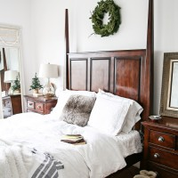 lovely white master bedroom with touches of greenery, warm throws, and texture for winter   maisondepax.com
