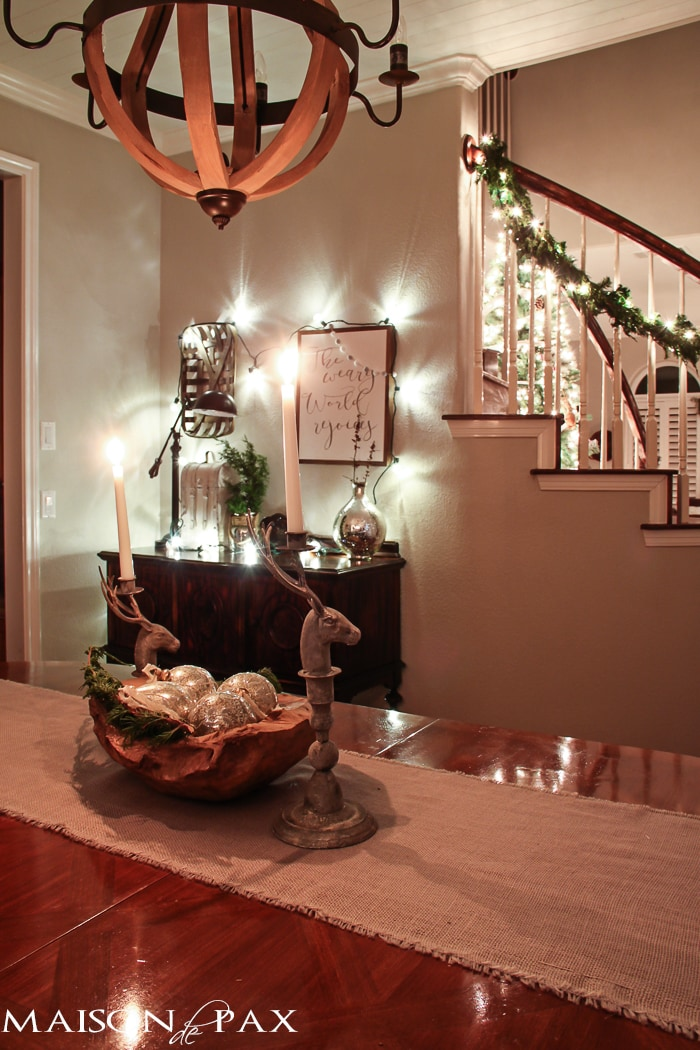 holiday decorating: globe christmas lights above buffet, lighted garland on stairs