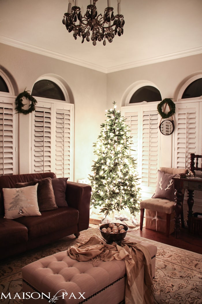 holiday decorating: christmas tree with white lights and mercury glass, antler pillow, wreath, sequin tree pillow
