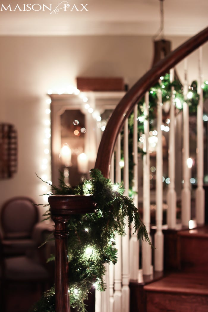 lighted garland on stairs, string lights on china cabinet