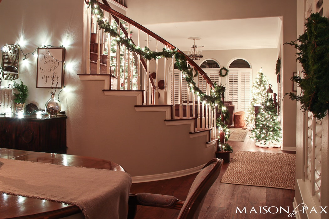 globe lights above buffet and lighted garland on stairs - lovely Christmas evening!