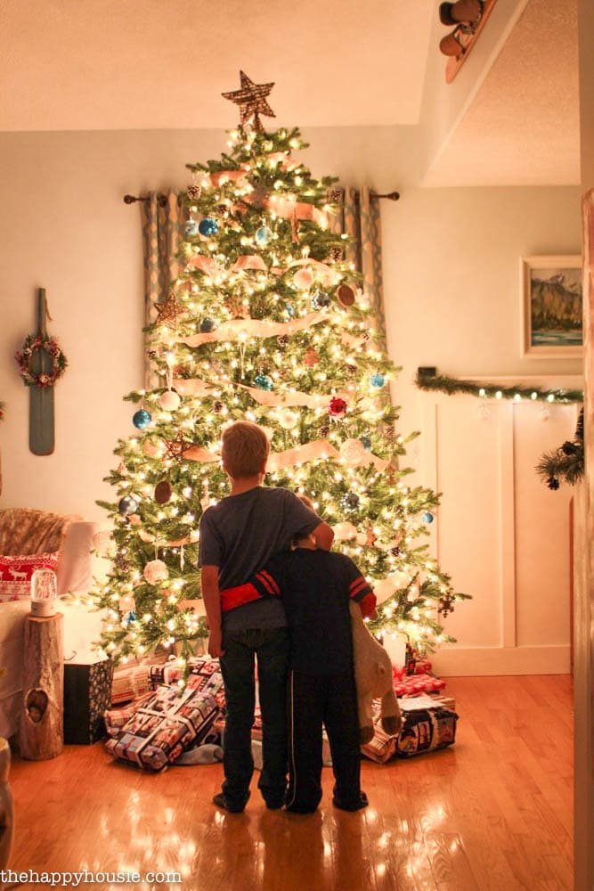 precious scene in front of the Christmas tree!