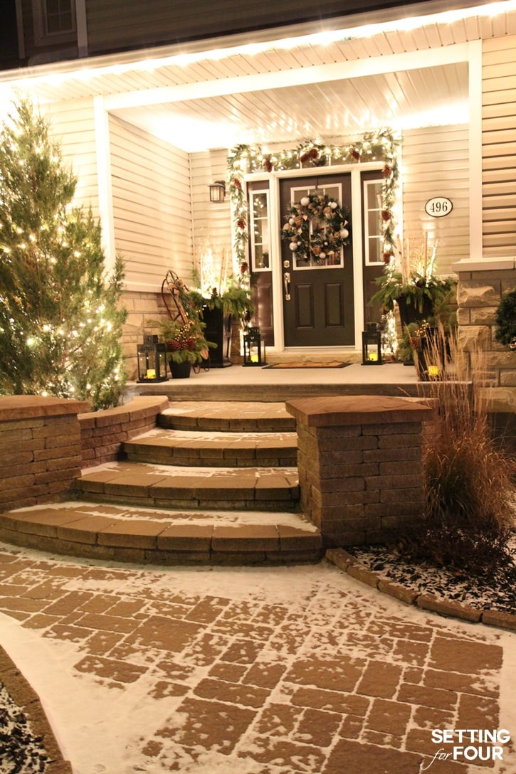 Stunning front porch decorated with Christmas lights!