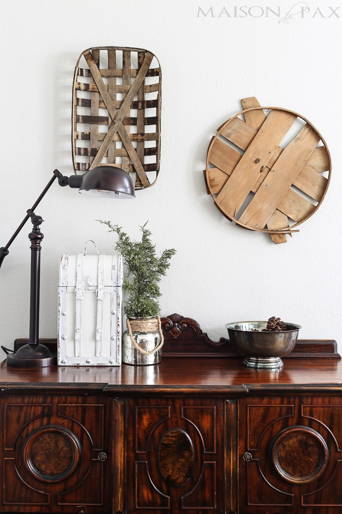 tobacco basket and bushel lid provide beautiful rustic contrast to a more formal dark wood buffet | maisondepax.com