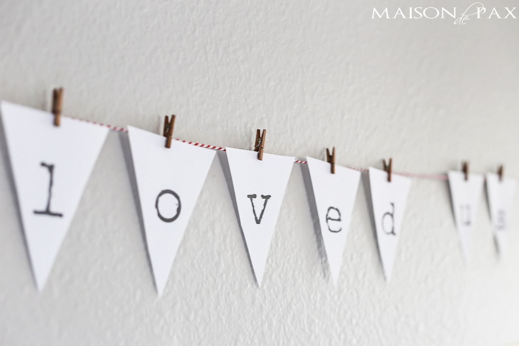 """""""he first loved us"""" adorable printable bunting on red and white baker's twine"""