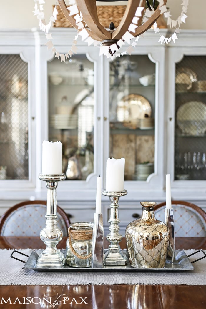 mercury glass vases and candlesticks on a galvanized tin tray makes a beautiful elegant yet rustic centerpiece for a dining room table
