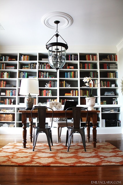 giant wall of bookcases - what a lovely office!