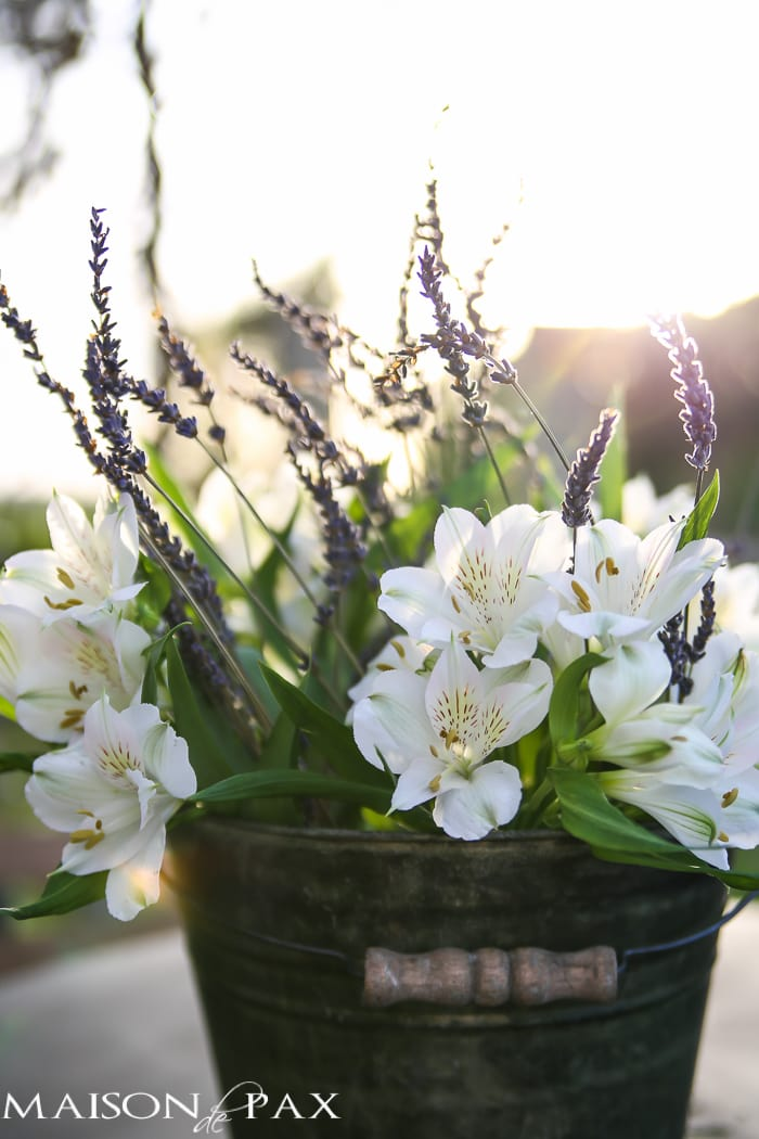 lavender and alstroemeria in a rustic bucket - such a simple and elegant centerpiece | maisondepax.com
