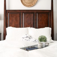 lovely, calming white master bedroom with natural wood tones and textures throughout | maisondepax.com