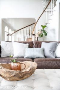 Gorgeous coffee table piece: succulent in a copper mug in a raw teak bowl... What a beautiful home with light touches of greenery perfect for spring or summer | maisondepax.com