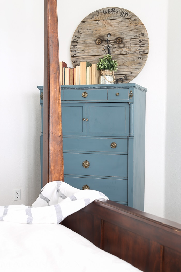 lovely soft yet deep blue antique dresser acts as an accent in this otherwise white bedroom | maisondepax.com