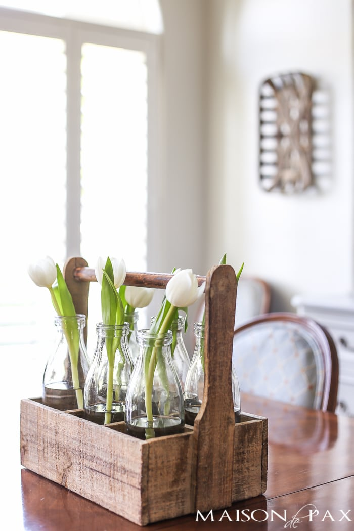 Love the rustic wood bottle caddy for holding single stem tulips! Tips for quick and easy decorating with flowers | maisondepax.com