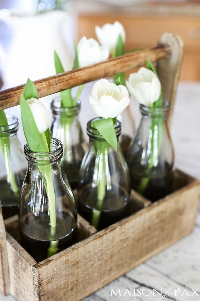 Single stem tulips in a rustic wood bottle caddy... Tips for quick and easy decorating with flowers | maisondepax.com