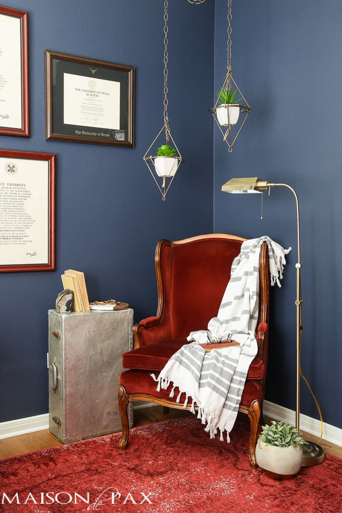 Love this dark, moody, navy office with red and brass accents