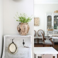 Raw teak vase... gorgeous! Beautiful summer home tour with lots of whites, raw wood tones, and simple decorating ideas
