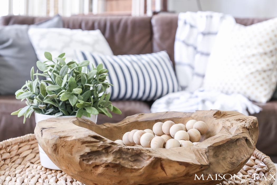 Love the wood beads in the wooden bowl! Beautiful summer home tour with lots of whites, raw wood tones, and simple summer decorating ideas