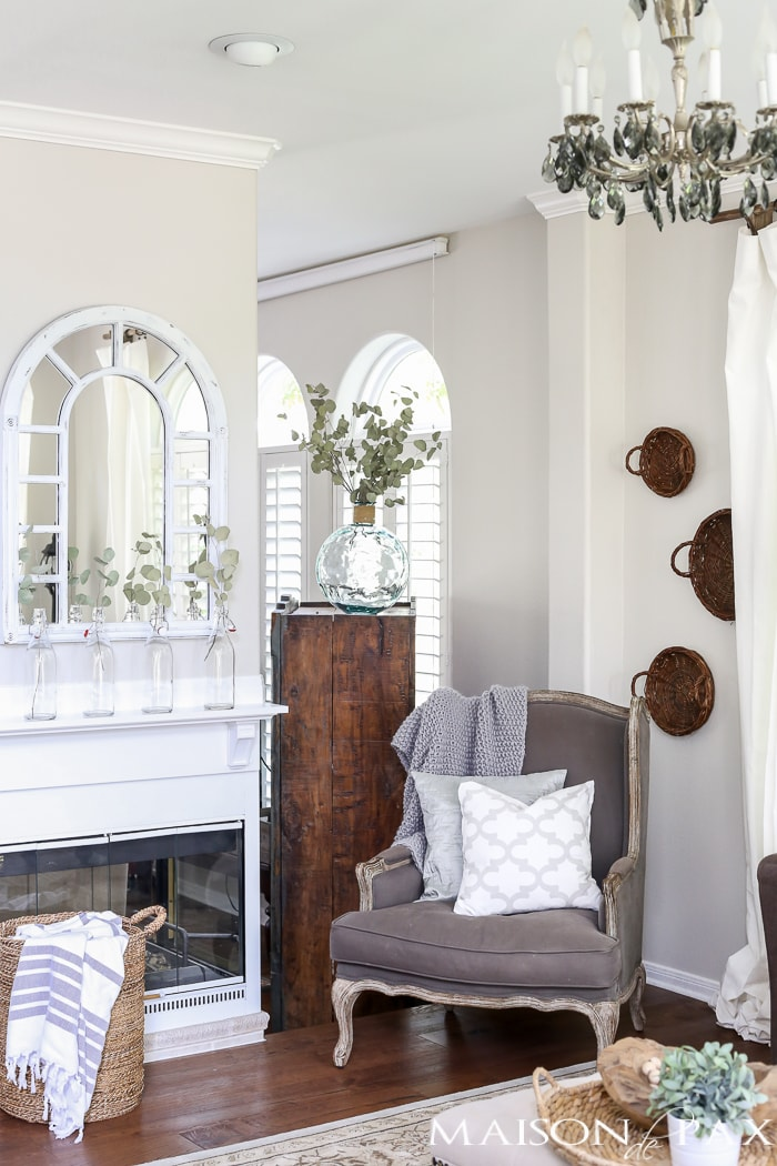 Beautiful mirror above the mantel! Beautiful summer home tour with lots of whites, raw wood tones, and simple decorating ideas