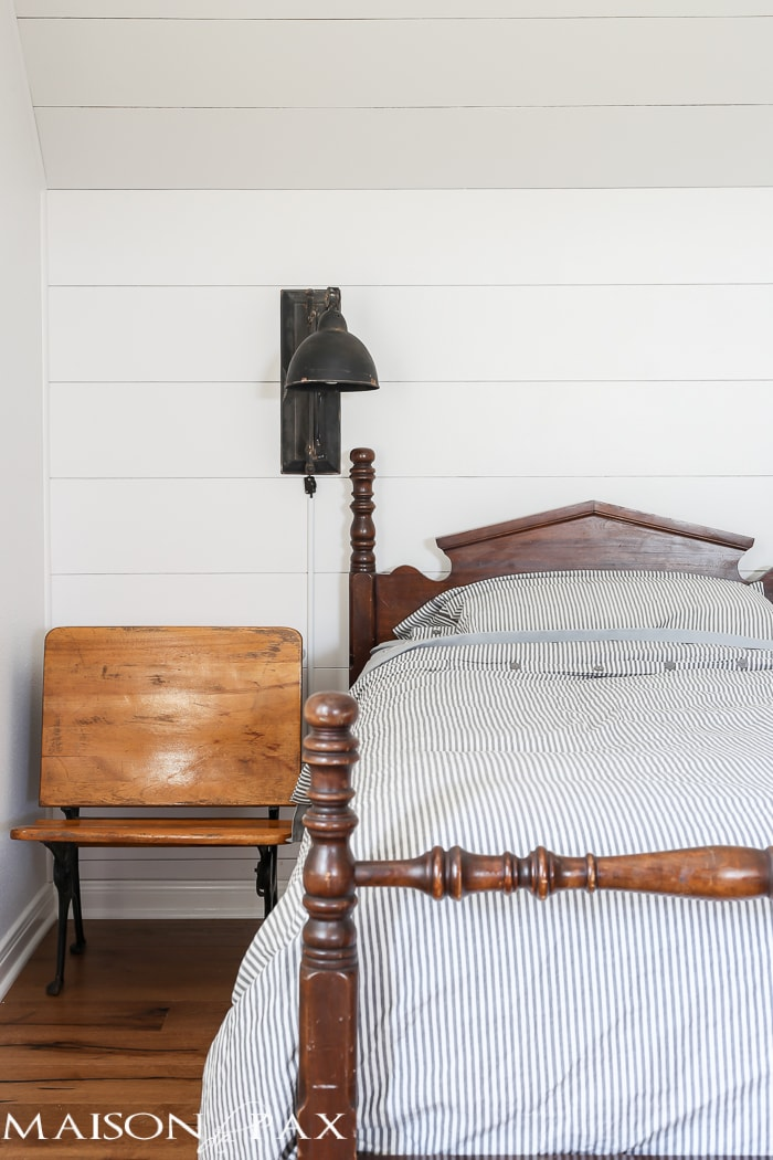 antique bed, vintage accordion sconce, shiplap walls, vintage school desk as bedside table... LOVE this little vintage bedroom!