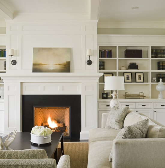 fireplace with white mantel and molding above