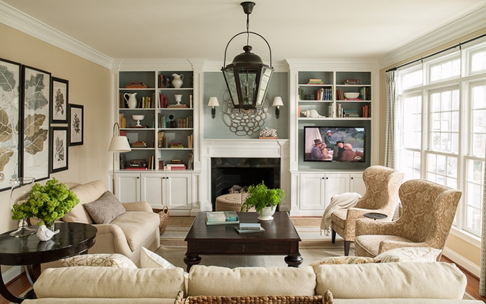 Traditional Fireplace With Built In Bookcases Holding Tv