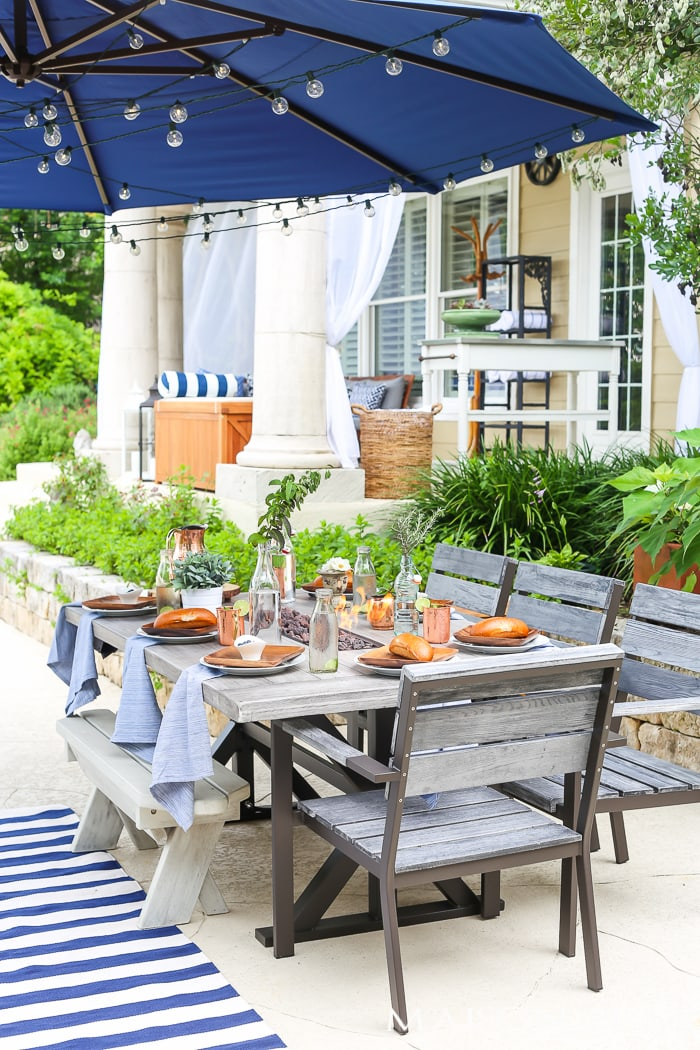 Outdoor Decorating Tips: mix and match chairs at a table to create more seating options and a casual feel