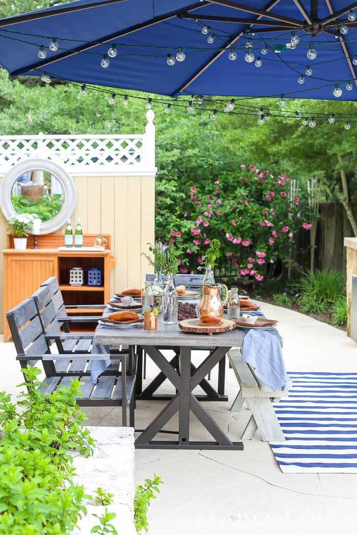 Outdoor Decorating Tips: globe string lights bring instant ambiance to an outdoor dinner party