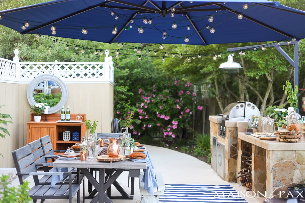Outdoor Decorating Tips: make your outdoor dining space usable with a giant shade umbrella