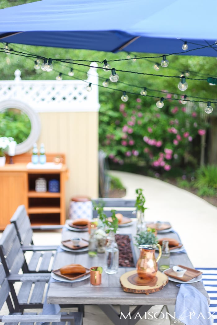Outdoor Decorating Tips: globe string lights at instant ambiance to an outdoor dining space