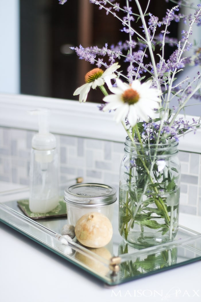 tip: use a glass tray for bathroom essentials... gorgeous with that marble backsplash!