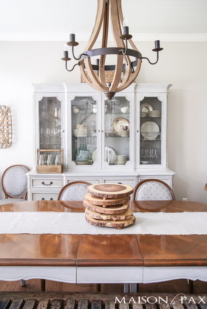Love this dining room! French furniture, wine barrel chandelier, and rustic accents
