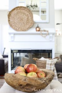 """Looking for easy fall decorations? Make your home light and cozy with these neutral decorating ideas perfect for early fall. _____________ Today is one of those days that catches my heart in my throat. A day when I feel all the feels about this job of mine and all the friends - like you! - that I get to connect with along the way. So please grab a real, hot cup of coffee (or your beverage of choice) and join me for a virtual, cozy chat curled up by the fireplace. Looking for easy fall decorating ideas? Check out this autumn home tour full of DIY, creative, yet simple fall decor! Today is the second annual Fall Into Home tour, where I have a handful of super talented bloggers joining me to share their cozy homes all decorated for fall. I cannot wait to share them all with you (links at the bottom) and to show you our home. I even put away the plastic shopping cart and paper airplanes in honor of your visit. ;) Looking for easy fall decorating ideas? Check out this autumn home tour full of DIY, creative, yet simple fall decor! I couldn't quite bring myself to deck the halls fully for fall yet as it's been over 90° every day still (ugh), and I haven't found anything but bright orange pumpkins for sale yet in these parts... But it gave me an excuse to stick to my neutral-loving style and simply make small adjustments to bring the house from """"light and airy"""" (my goal in our summer home tour) to """"cozy."""" First stop: entryway. Looking for easy fall decorating ideas? Check out this autumn home tour full of DIY, creative, yet simple fall decor! Looking for easy fall decorating ideas? Check out this autumn home tour full of DIY, creative, yet simple fall decor! I found this beautiful succulent when I was shopping for my pumpkin succulent planters a few weeks ago, and I added it to my teak vase. I love enjoying the beauty of practical accessories like rain boots and scarves. The candle lantern may be a little less practical, but no less beautiful, right? Looking for easy fall d"""
