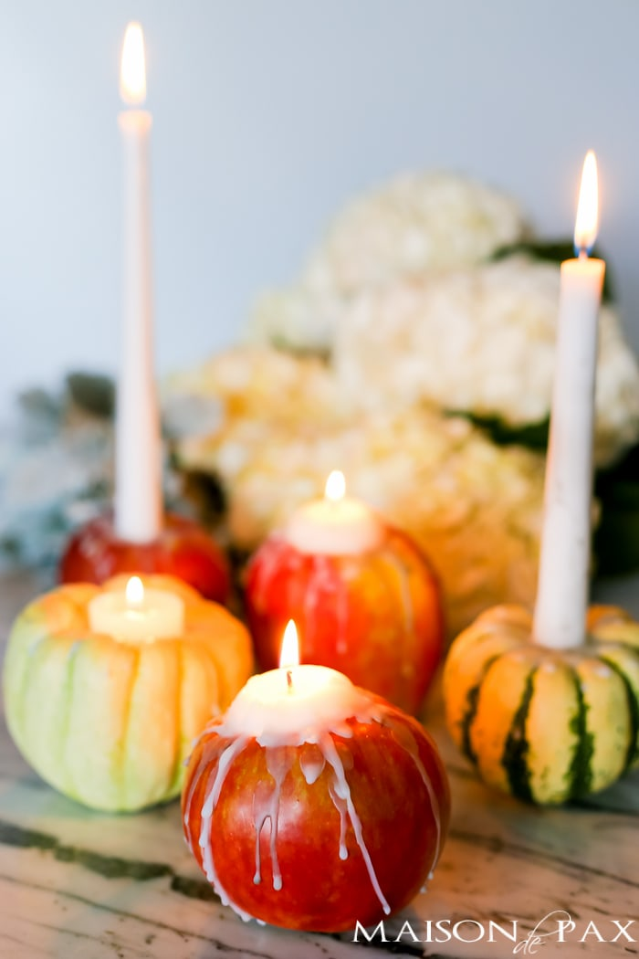 Looking for creative, easy fall decor? Learn how to make adorable mini pumpkin, gourd, and apple candles with step by step instructions and a video tutorial!