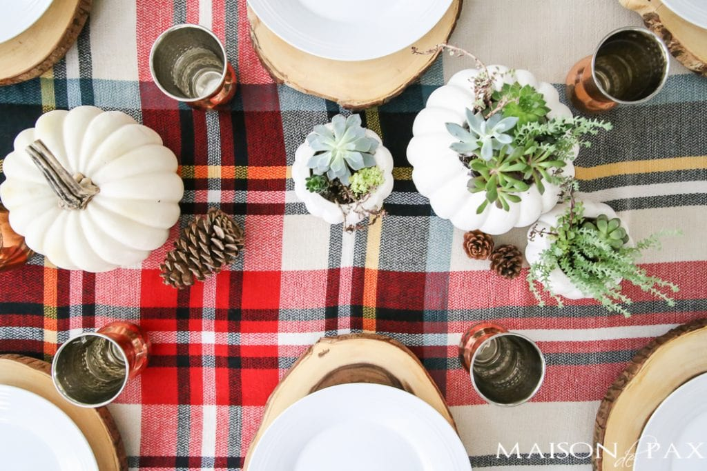 Be inspired to create a gorgeous, rustic Thanksgiving tablescape with these Thanksgiving decorating ideas! This table incorporates plaid, copper, and wood to create a beautiful yet relaxed look.