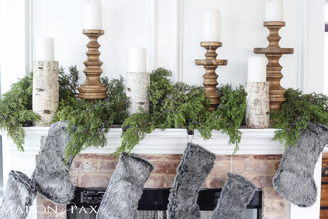 Winter Woodland Christmas Mantel: Looking for mantel decorating ideas? Some fresh cut cedar, candlesticks, and a faux deer mount creates the perfect holiday decor.